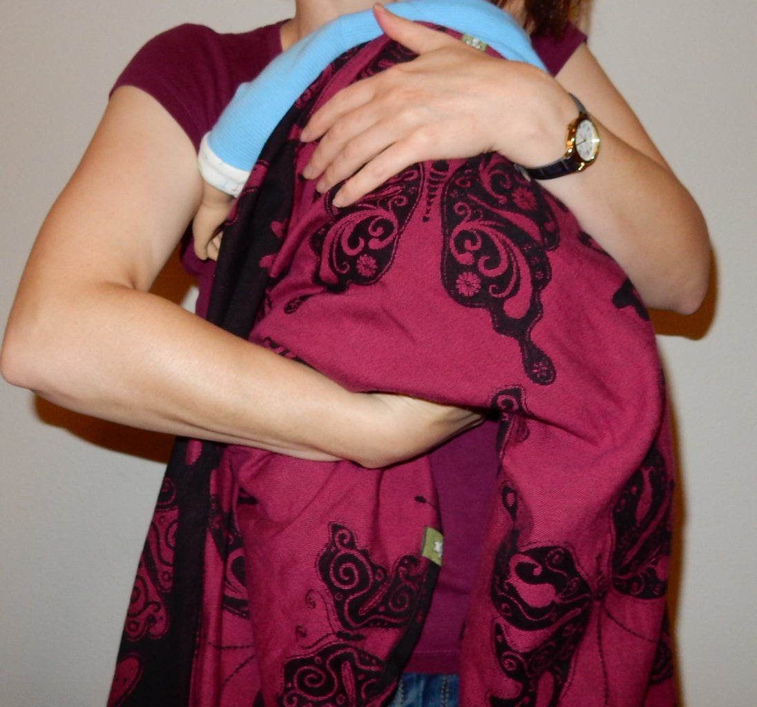Tuck the Bottom of the Wrap Up to Make a Seat for the Baby.