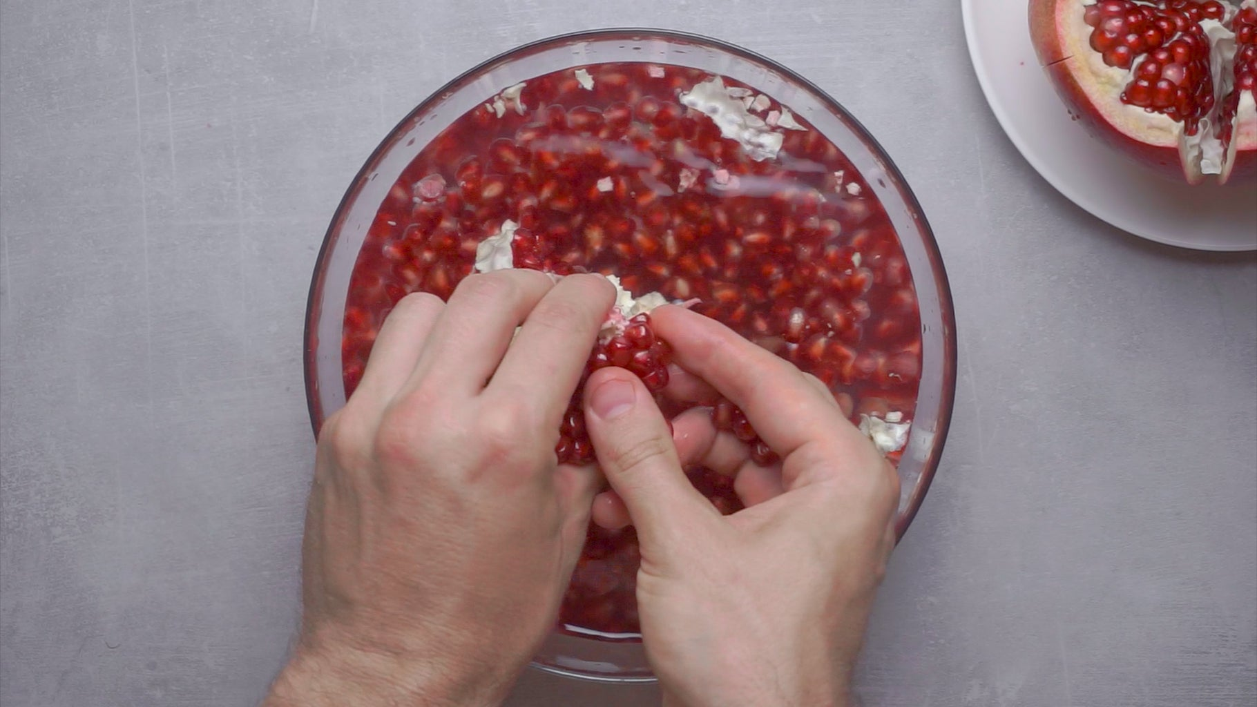 Place the Pomegranate Into a Bowl of Water and Peel It There