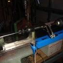 Semi-automatic spoke threading machine