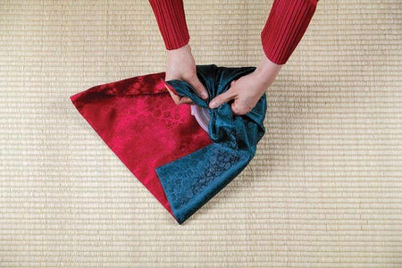 While Covering the Container One Corner at a Time  in the Order Shown, Gather Each Ear Snugly. Weave the  Fourth Ear Beneath the First to Create a Hash Shape
