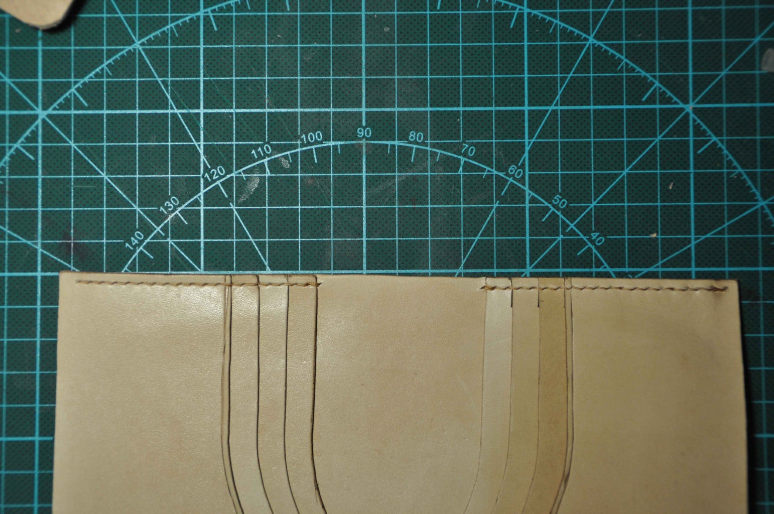 Sew the Upside.And Don't Forget to Sew the Bottom of the Card Slots. Each One Should Be Sewed.