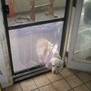 Easy, Inexpensive Doggy Door in a Screen Door