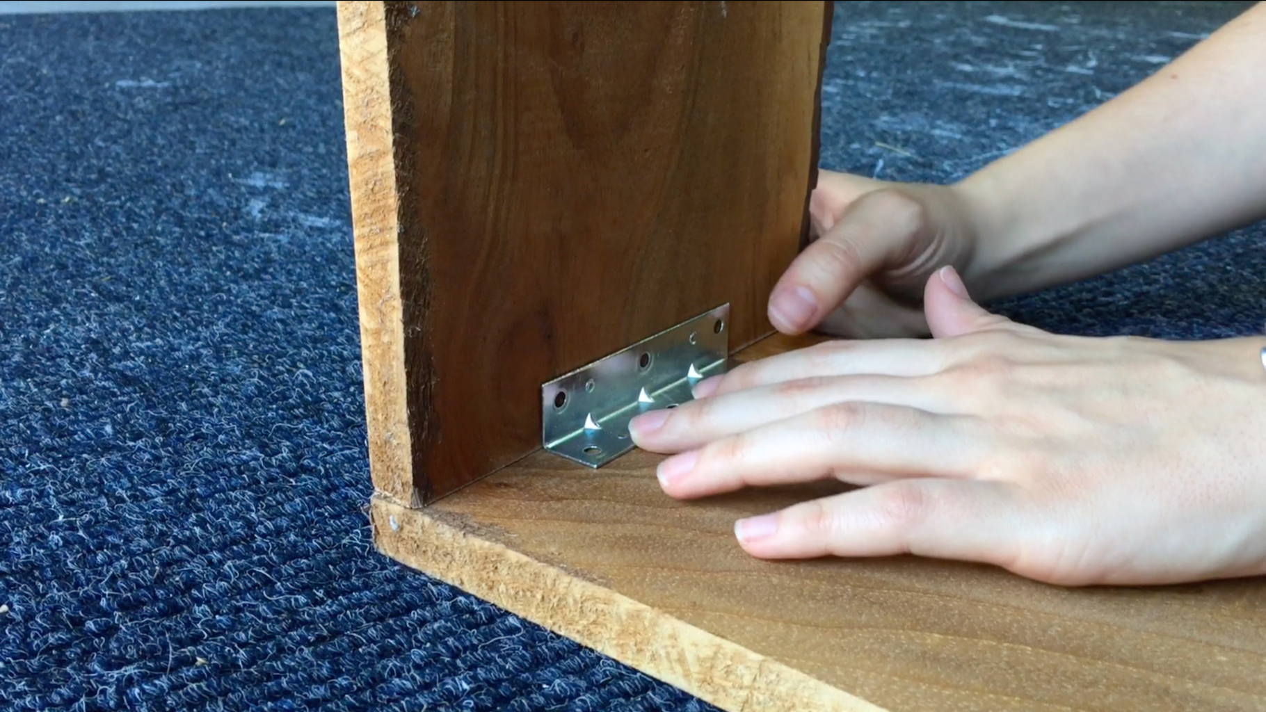 After Making Cuts, Attach Corner Brackets to Sides of Board.