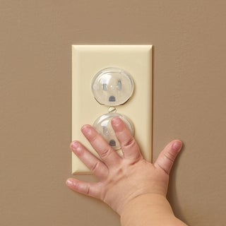 outlet-safety-cover-with-tiny-hand.jpg