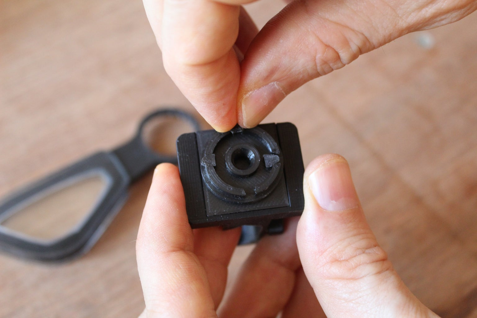Assembling the Lens Rotating and Blocking Mechanism