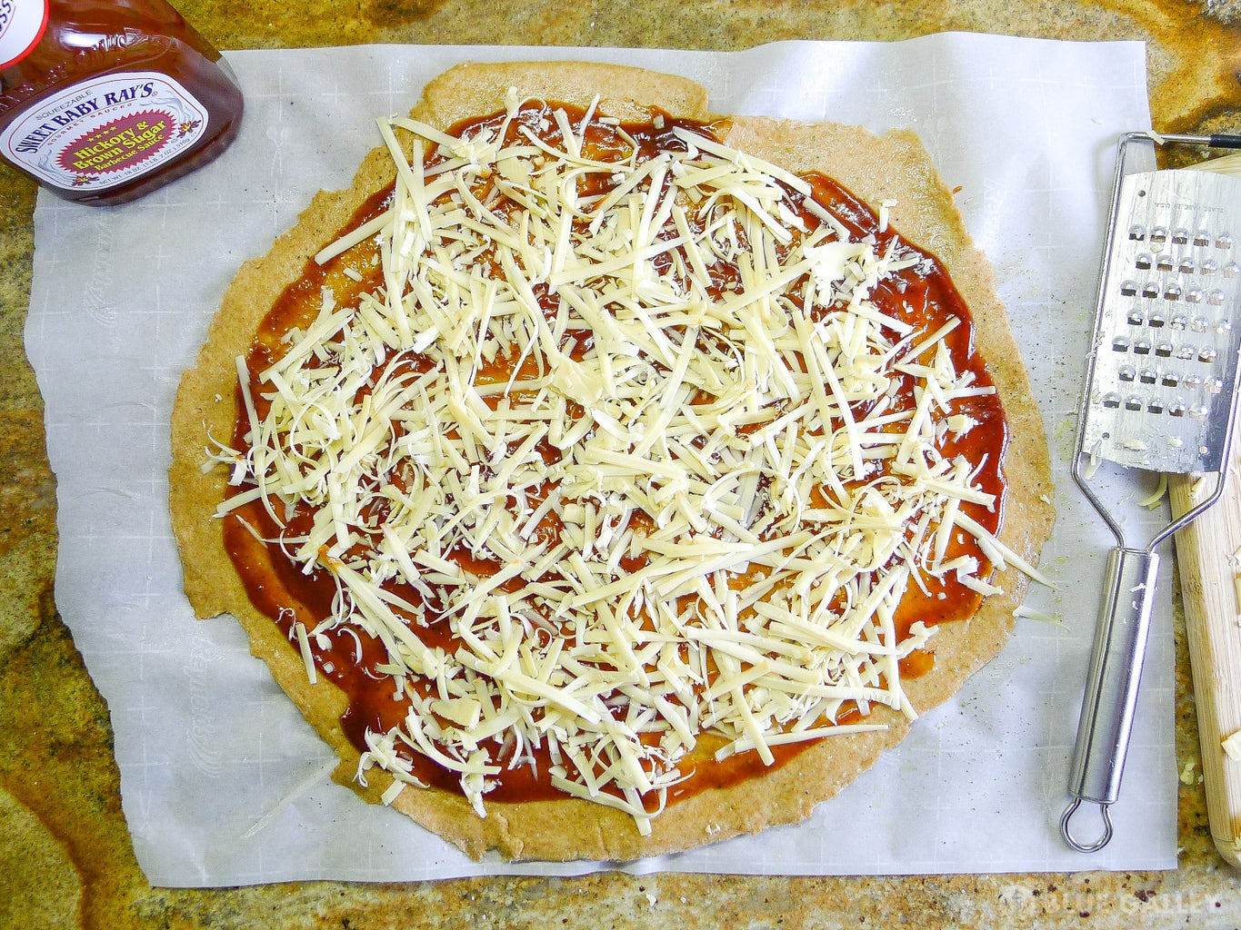 Spread Sauce and Cheese: