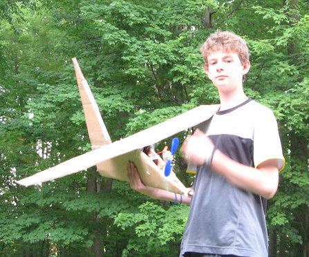 Huge cardboard airplane with propeller that is powwerd by motor