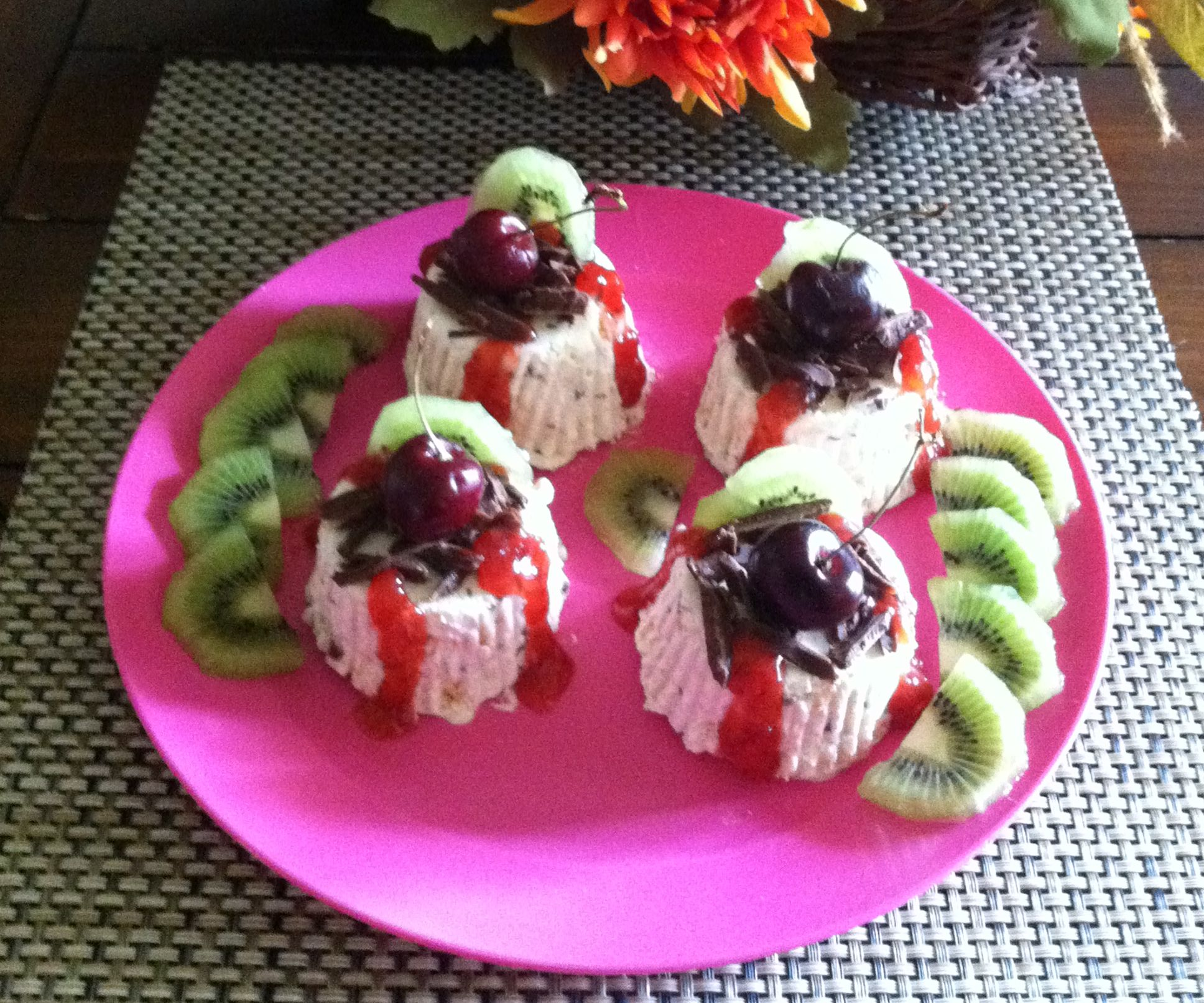 Meringue and Coffee Liqueur Semifreddo topped with chocolate shaving,strawberry preserve,kiwi and cherry