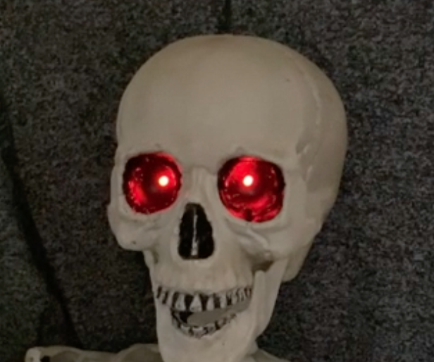 Skeleton With Dimming Red Eyes