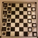 Make chess pieces out of mosaic tiles