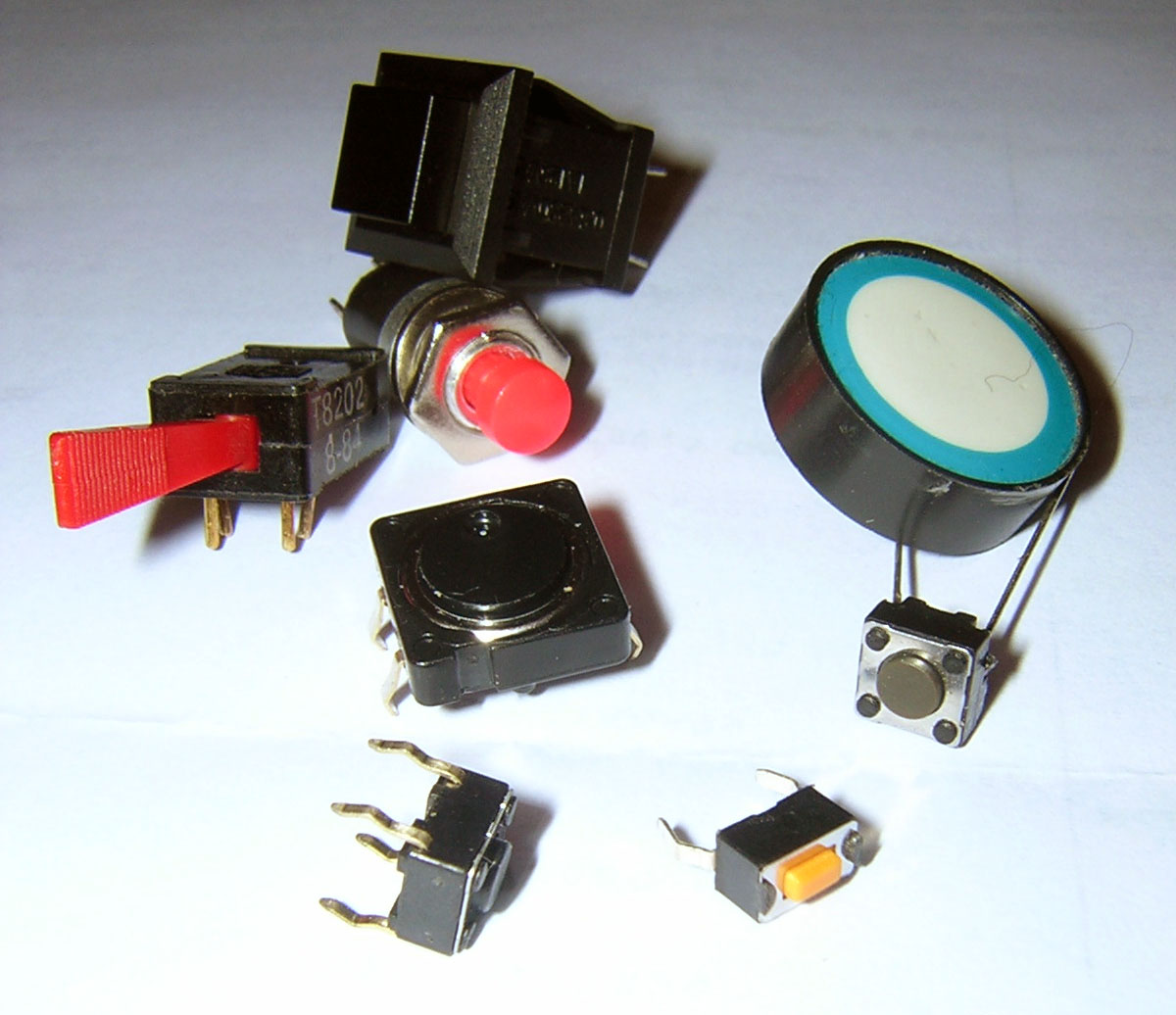 Use a Momentary or Tactile Switch as a Pushbutton Switch.