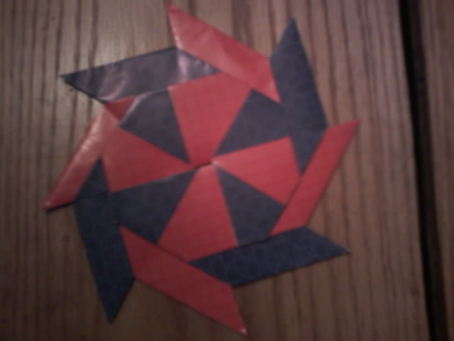 Origami transforming star and frisbee