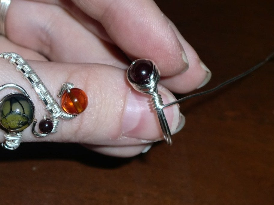 Wire wrapped rings with glass or plastic bead