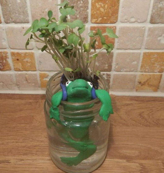 Miniature self watering animal pot