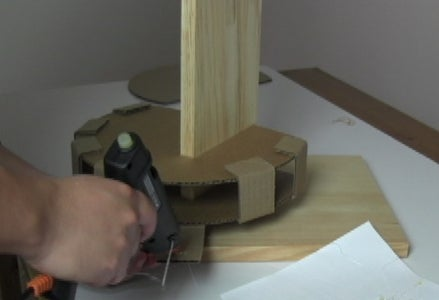 Assemble Two Cardboard Round Parts of the Robot Arm.
