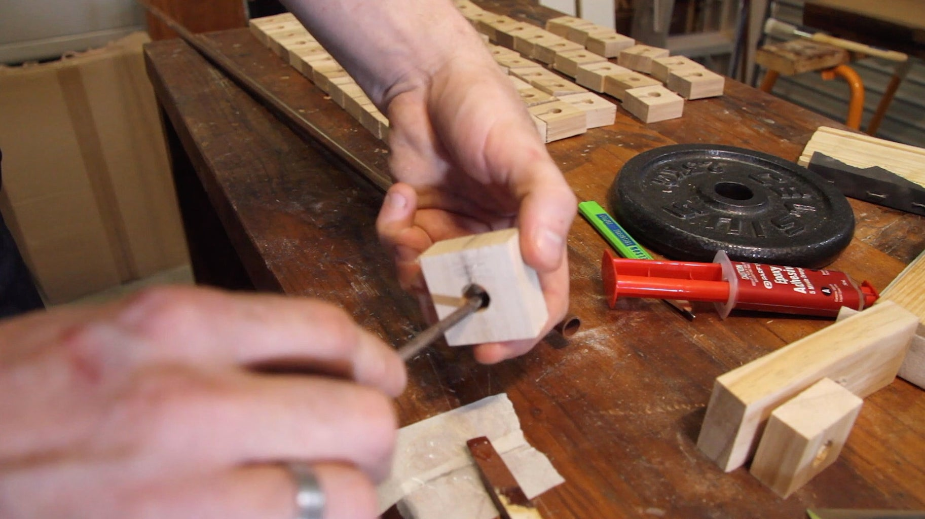 Slide Wood Squares Onto Copper Pipe to Make the Shaft