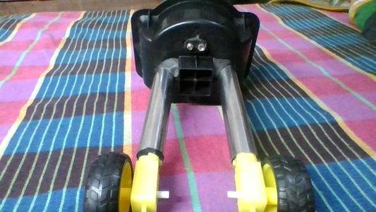 Adding Motors and Wheels to Robot Leg.