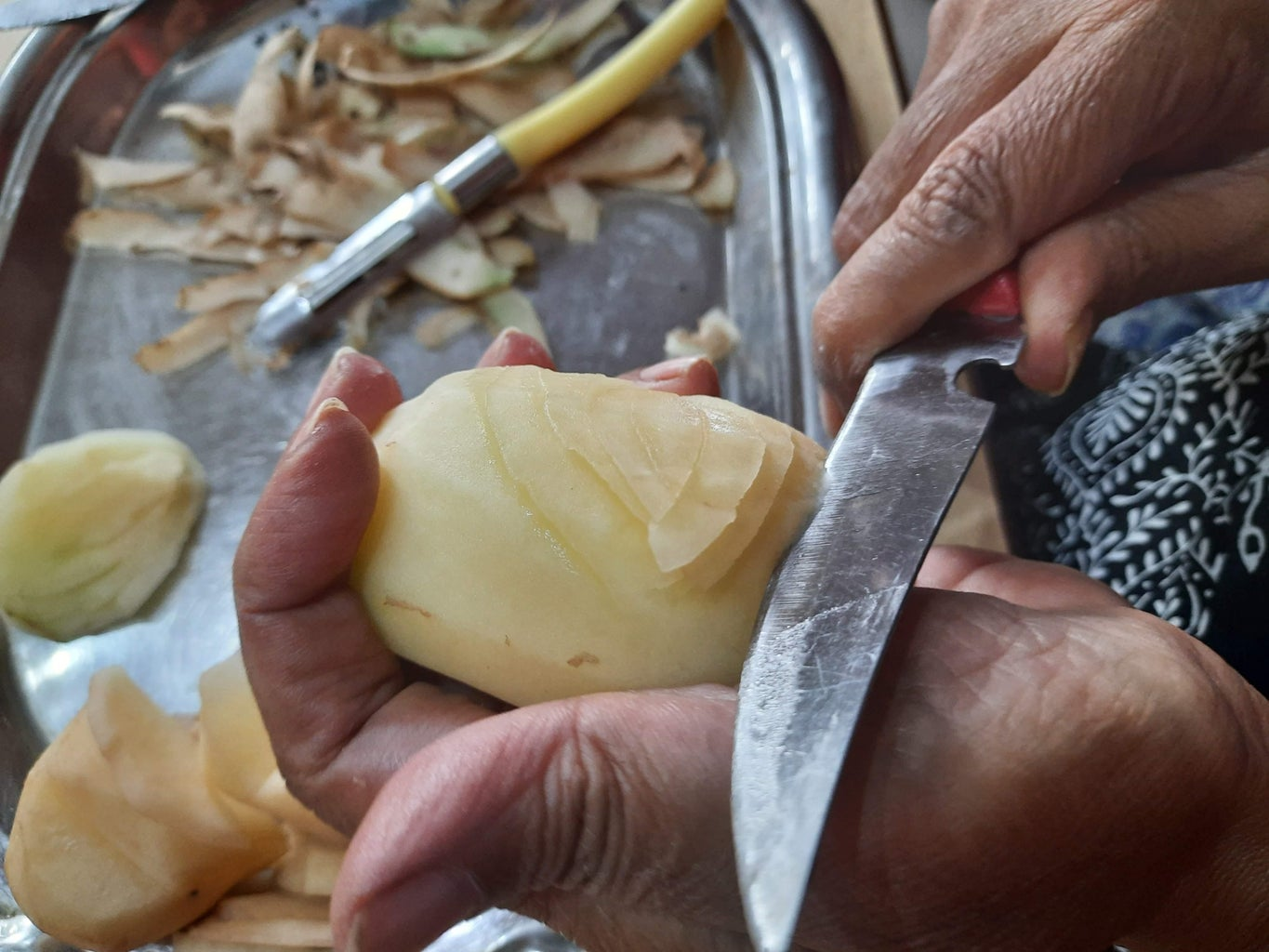 Cutting the Potatoes to Make Wings