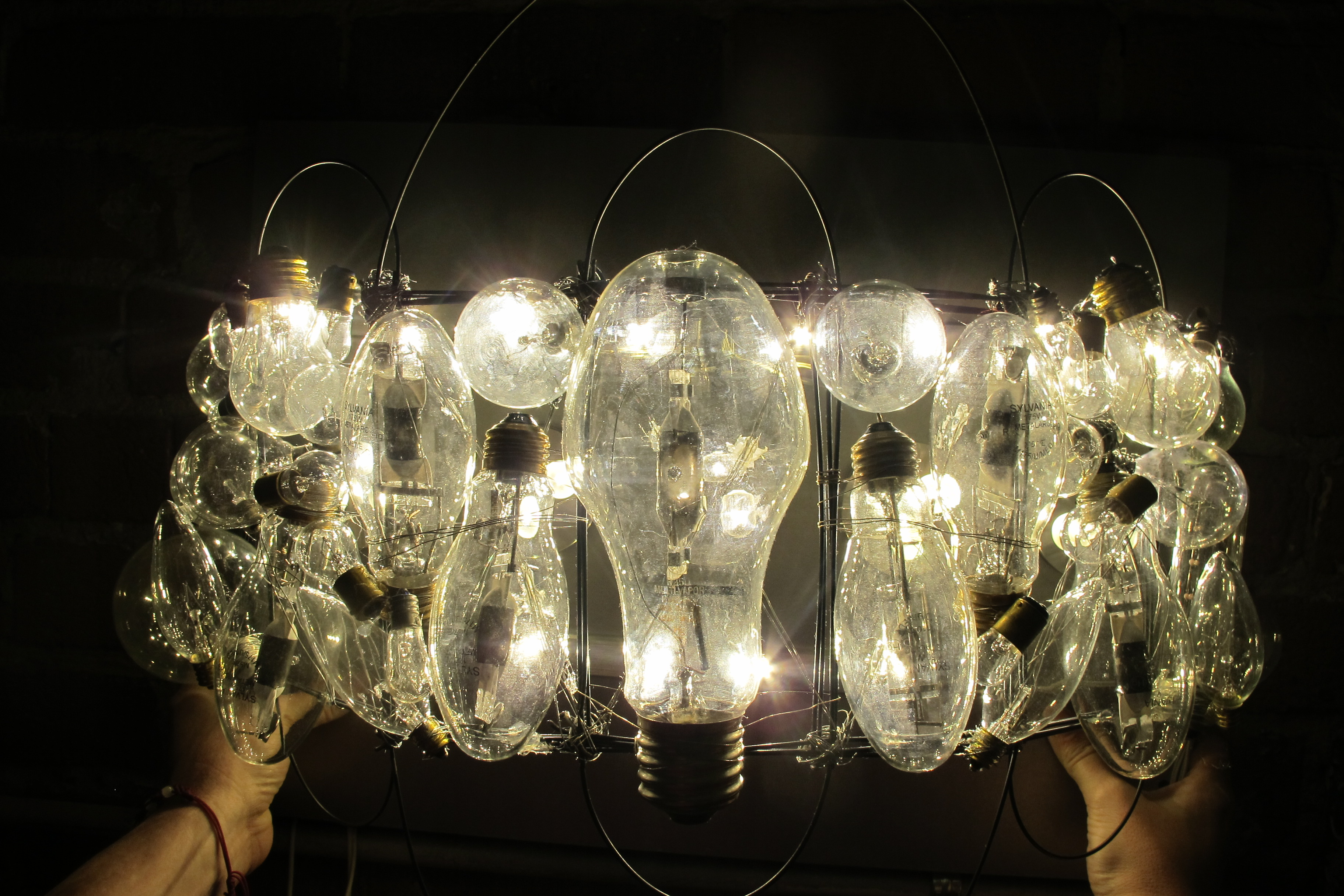 Incandescent Bulb Wall Sconce Illuminated with LED Bar and Puck Lights