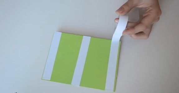 Stick the Green Cardboard on the White One.