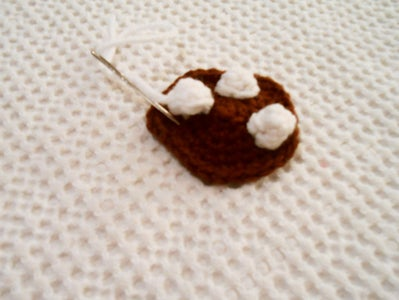 Sewing the Marshmallows Onto the Chocolate