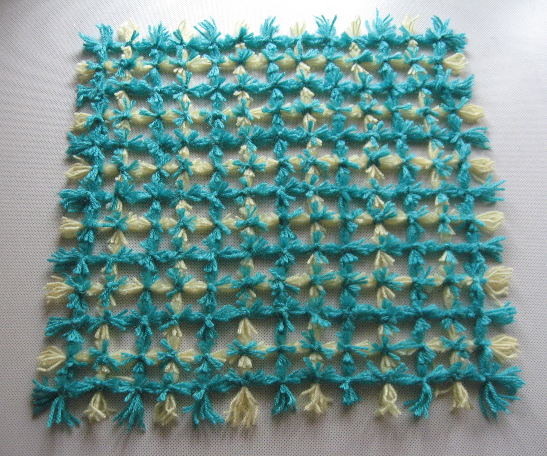 Weaving a Pom Pom Mat