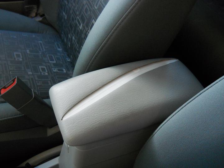 Repairing a car console armrest