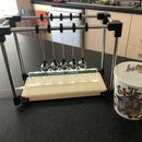 Newtons Cradle With Edge Lit Explanation