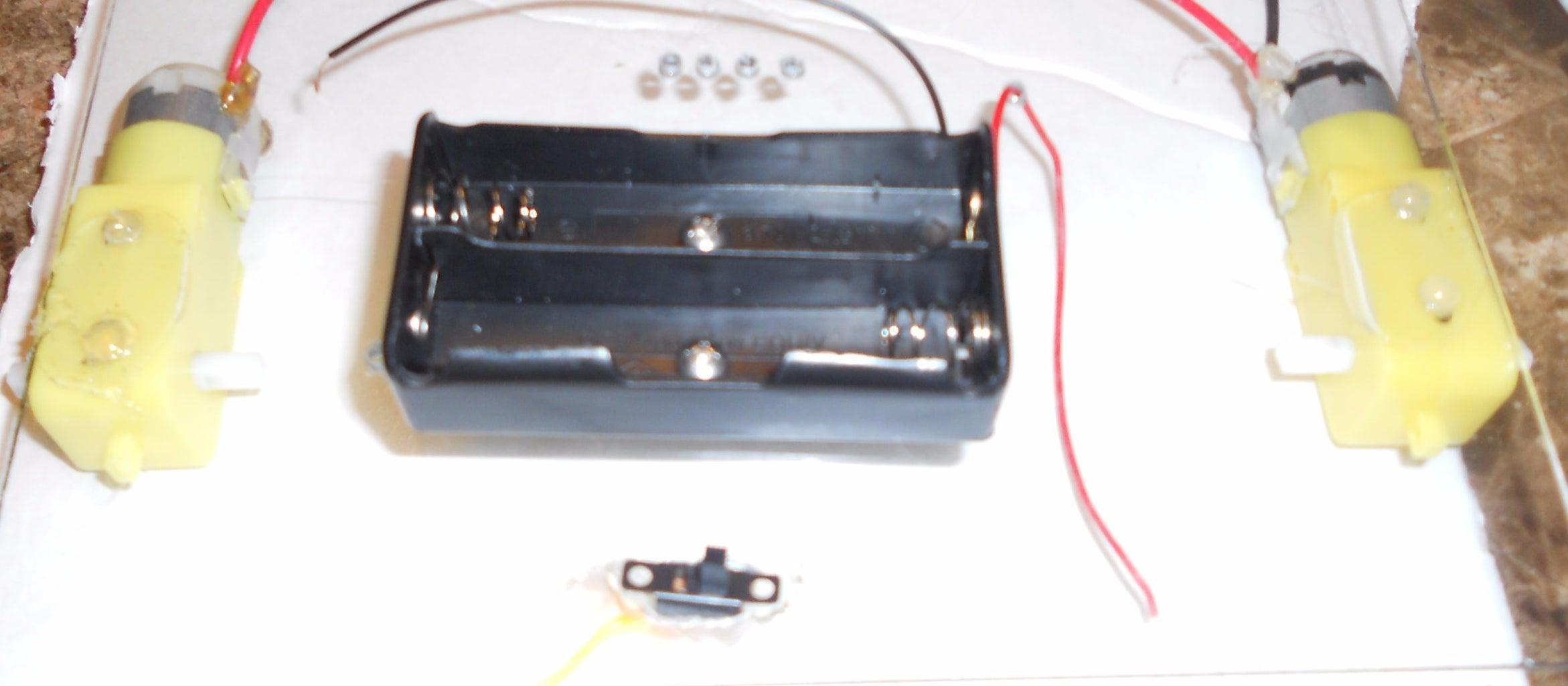 Screw in the Battery Holder