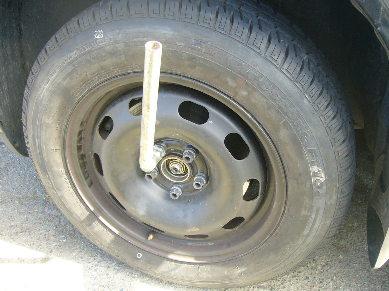 Partially Lower Your Vehicle - Tighten Lugs
