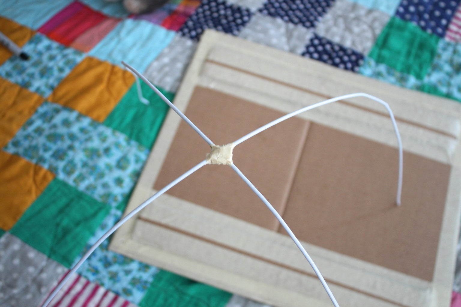 Tape the Two Hangers Together
