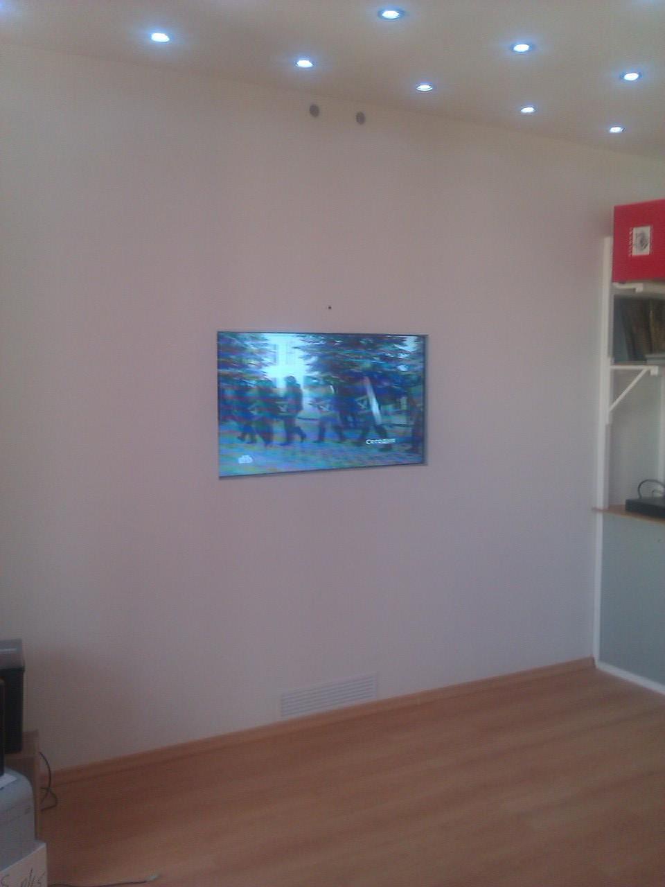 Hide an LCD TV behind drywall