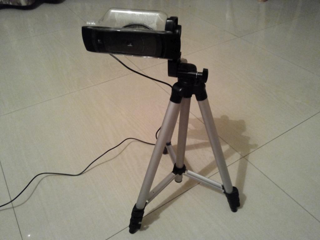 Webcam tripod adapter