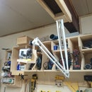 Hanging camera slider with arm extension