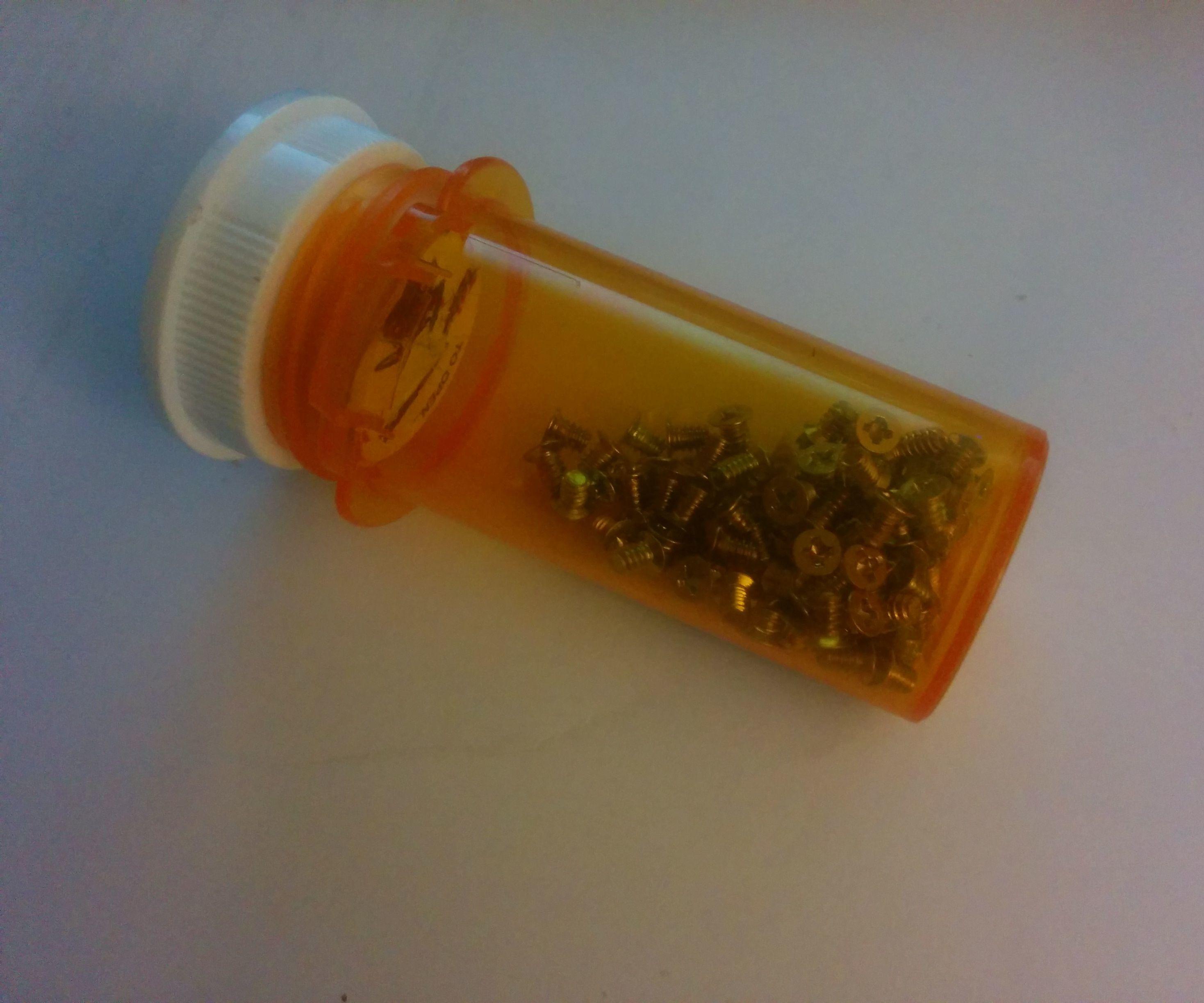Recycled Pill bottle screw catcher. X-top-cap