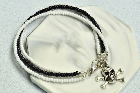 The Finial Look of the Pearl Beaded Bracelet With Three Strings: