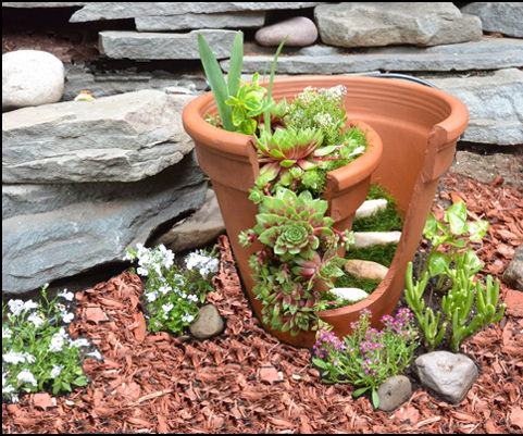 Clay flower pot - with a twist