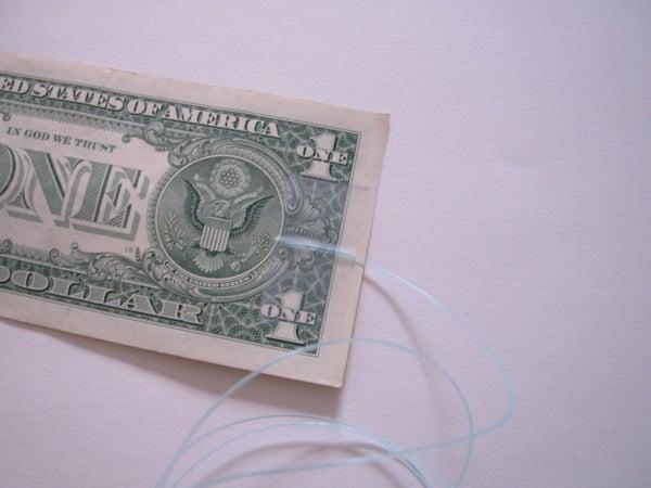 Dollar Bill on a String