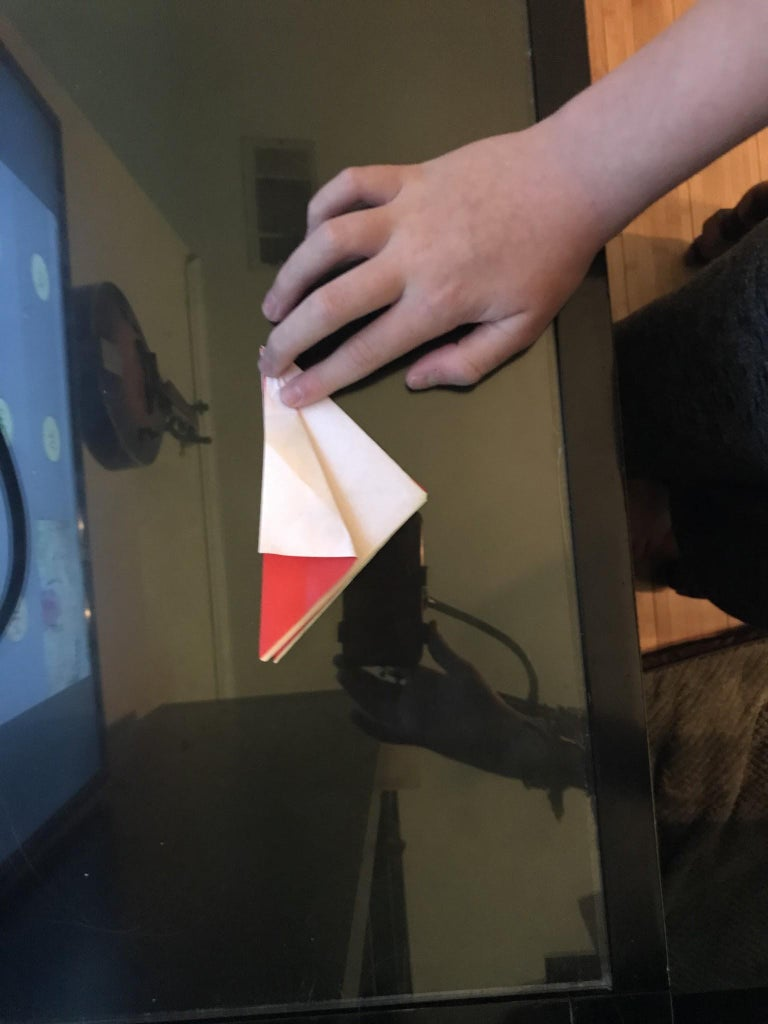 Step 12: Fold That Back Down and Then Make a Diagonal Fold With the Corner