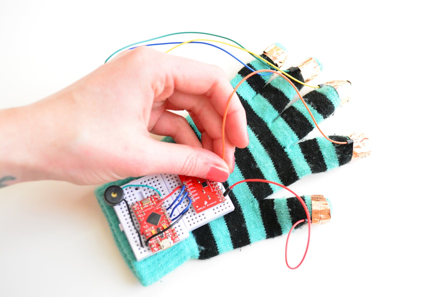 WIRE FINGERTIPS TO THE CAPACITIVE SENSE BREAKOUT