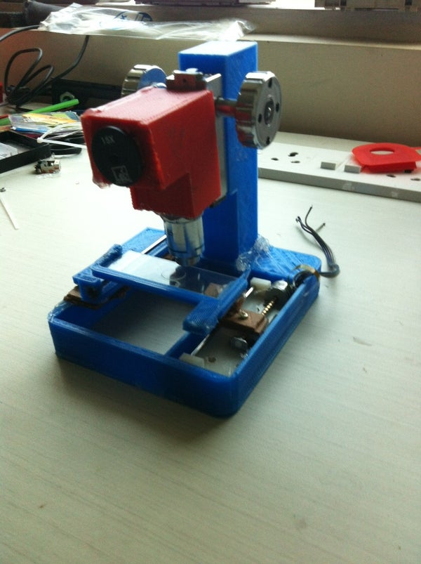 Low Cost Digital Microscope With Automated Slide Movement