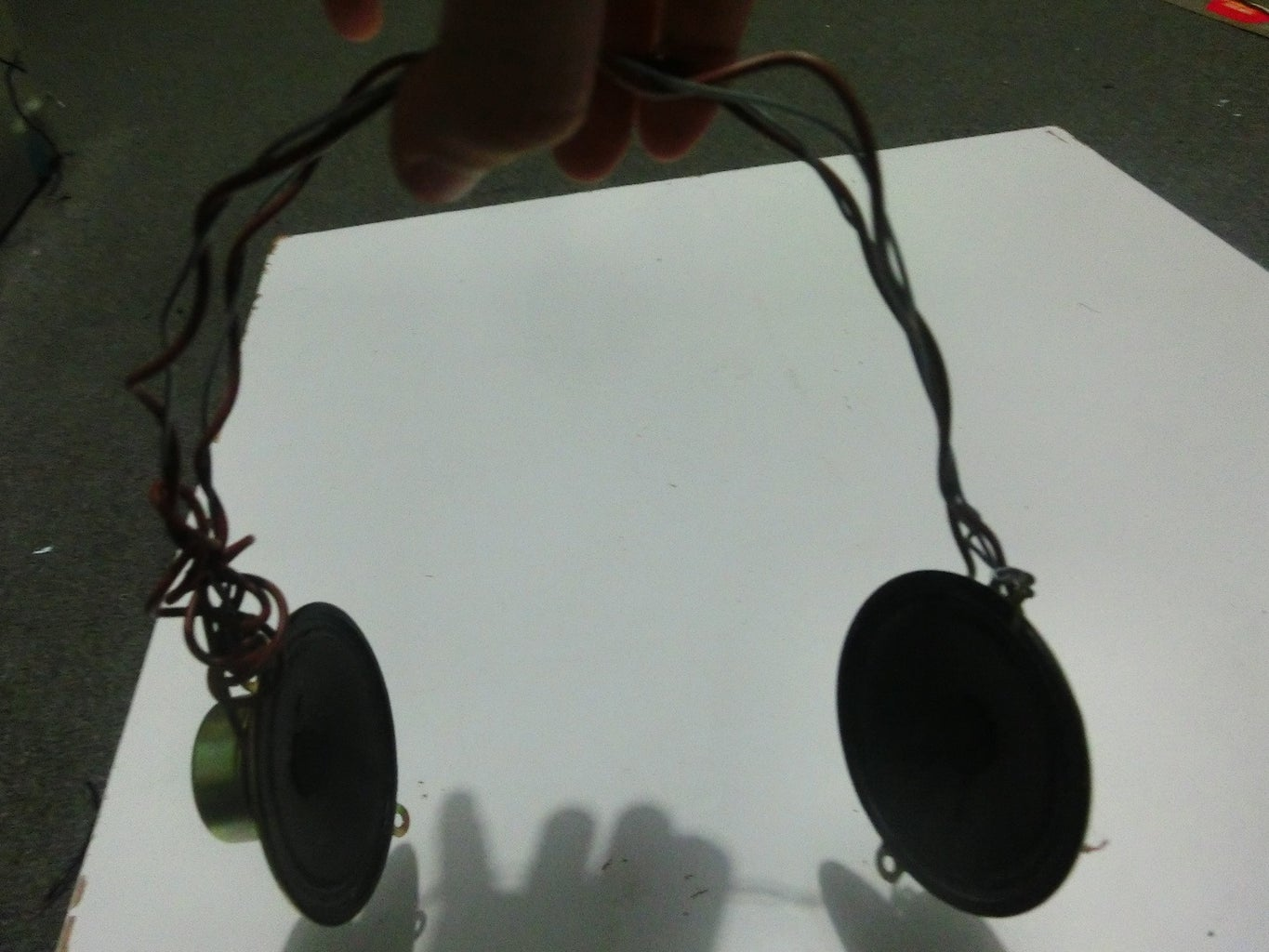 Attaching the Two Wires to the Speakers and the (long) Wire to the Speakers.
