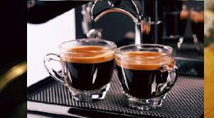 ADD THE ESPRESSO SHOTS TO THE EXTRA-STRONG BREWED CUP OF COFFEE