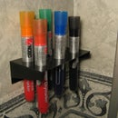 Wall mounted whiteboard pen holder
