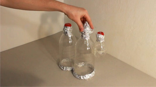 Shaping the Fairy House With Tin Foil
