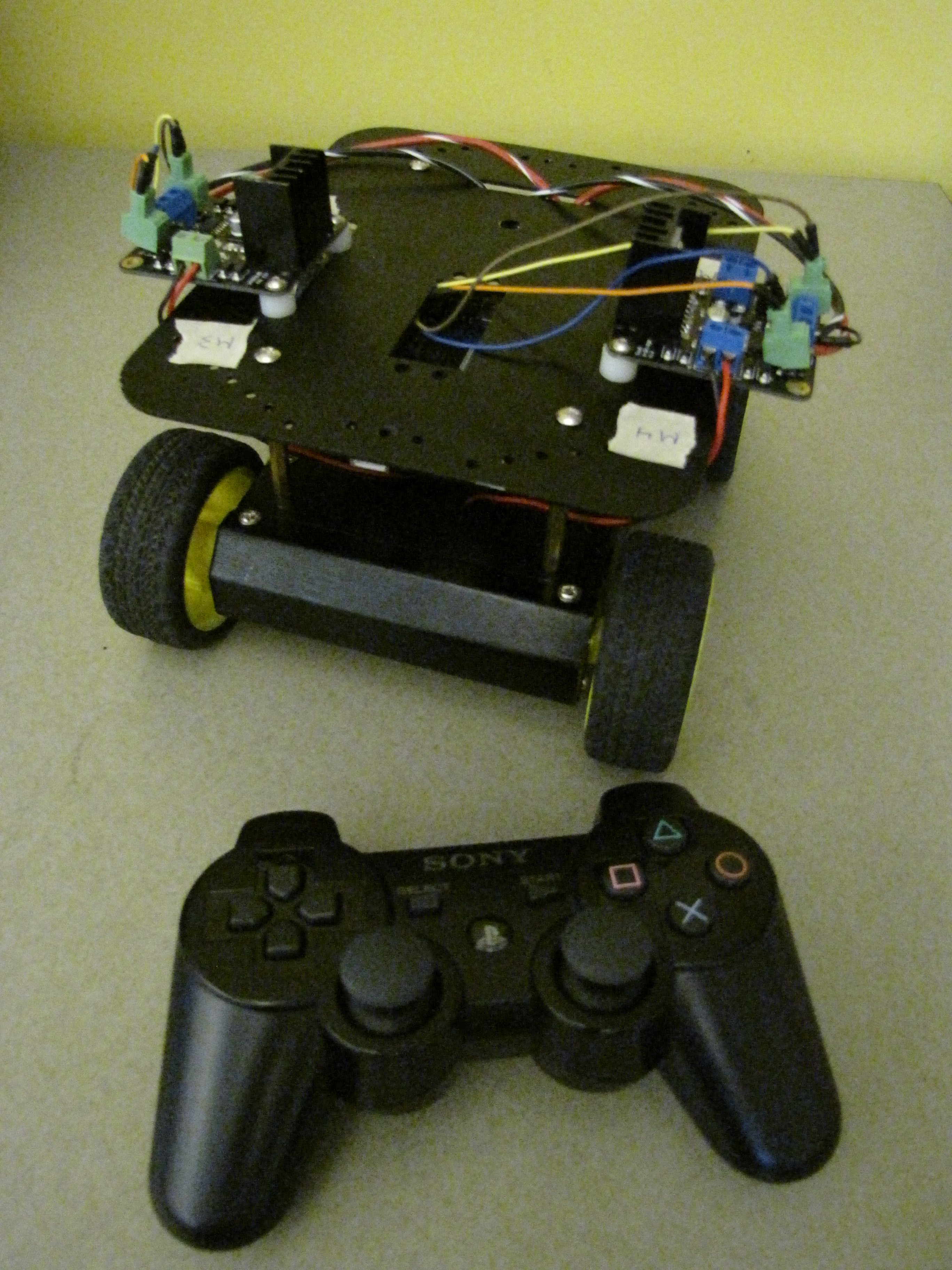 Robot driven by PS3 controller through Arduino and Wifi shield