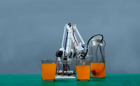 Automatic Robotic Arm Bartender Using Evive- Arduino Based Embedded Platform