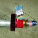 Ribbon and tape holder from dry cleaning hanger