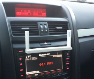 Universally Mounted Phone Holder. Can Fit Into CD-player Slot! and Other Places..
