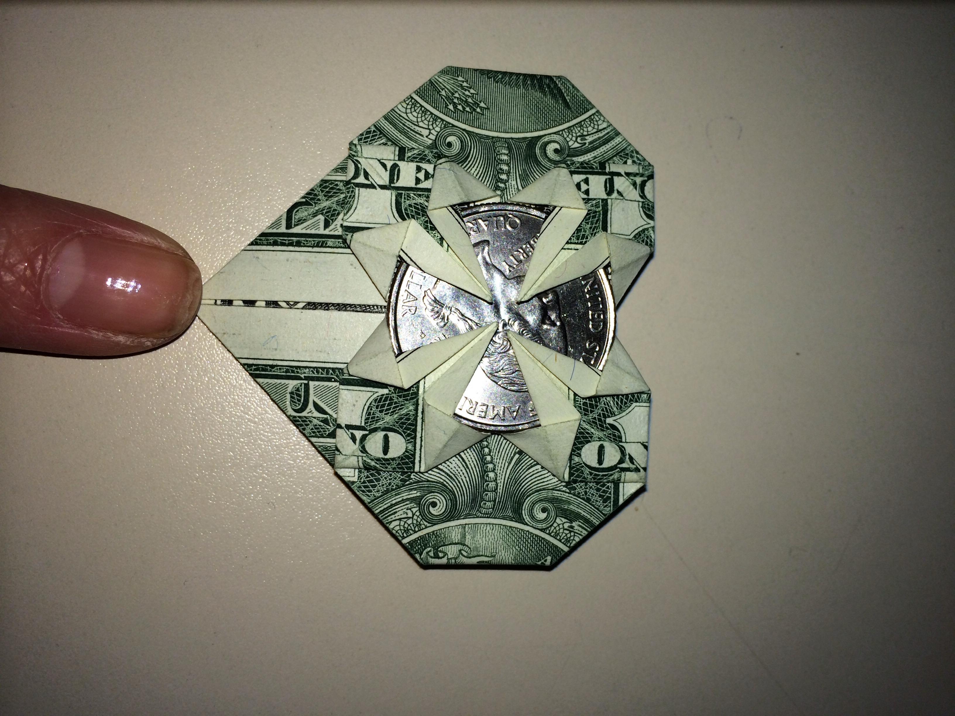 Dollar Origami Heart Holding Quarter